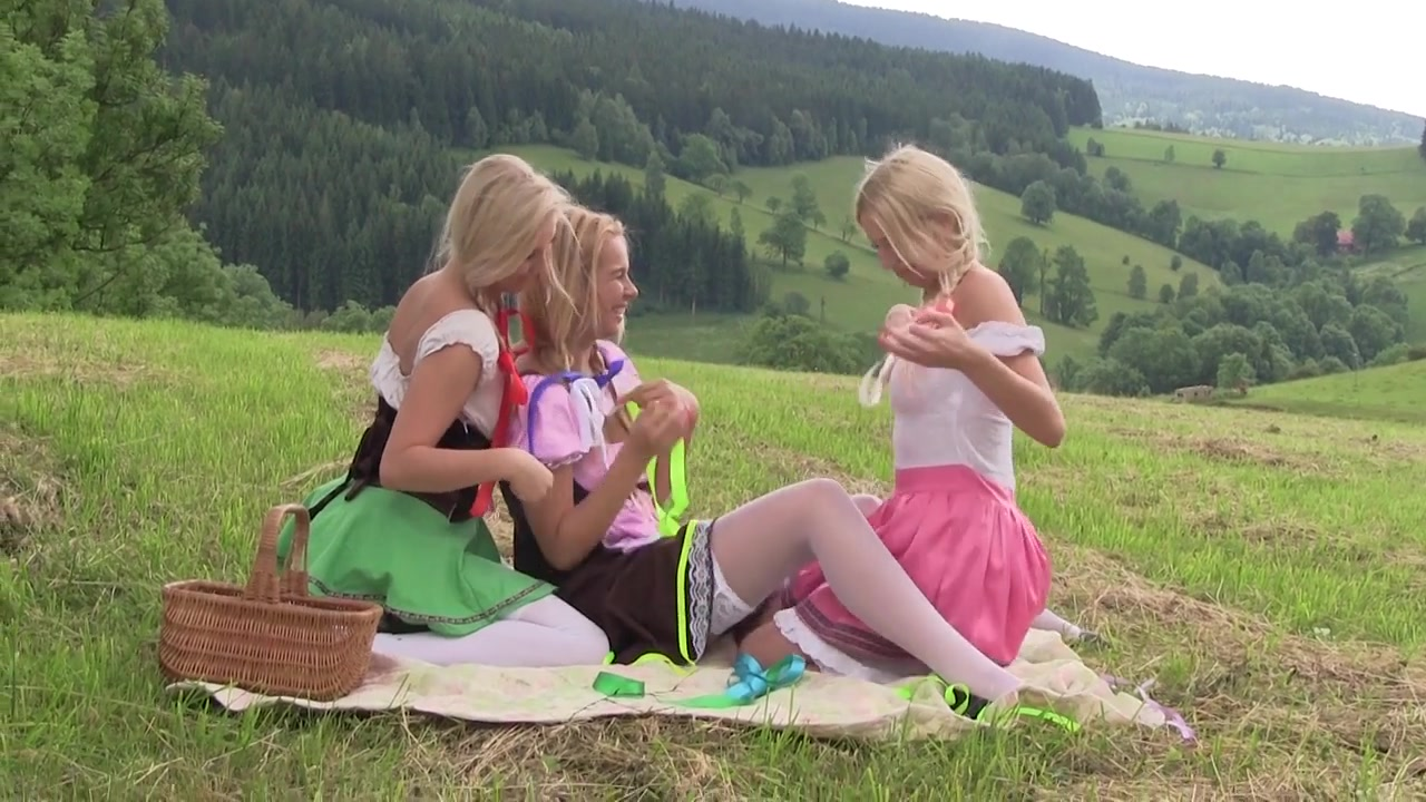 Blonde Babes Lick Each Other on the Countryside